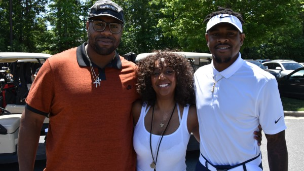 Tammie Tolbert with NFL Players at TDDDF Celebrity Golf Event.jpg