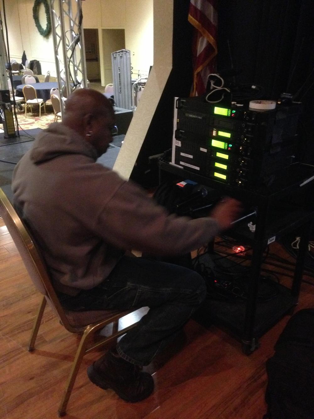 Tony programming the wireless mics.