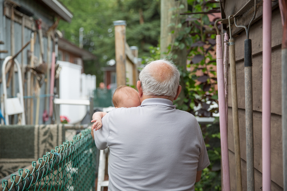"""Marcello calls to """"Pascuale"""" his neighbour,they have attached a make-shift ladder steps to connect their backyards together to make visits easier. We joined them for coffee, Marcello was quiteproud to introduce his great grand-son."""