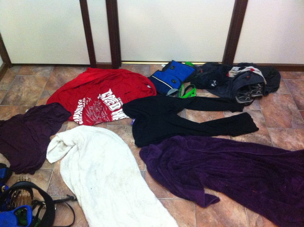 The clothes thrown off in our rush. Note the light coloured dry patch on J's red t shirt. Every item there is SODDEN.