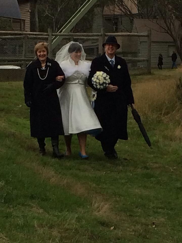 Walking down the aisle with mum and da. Mum is wearing a brooch of her mother's, and my da is wearing his mother's clan kilt pin, so I had many important people in my life present with us.