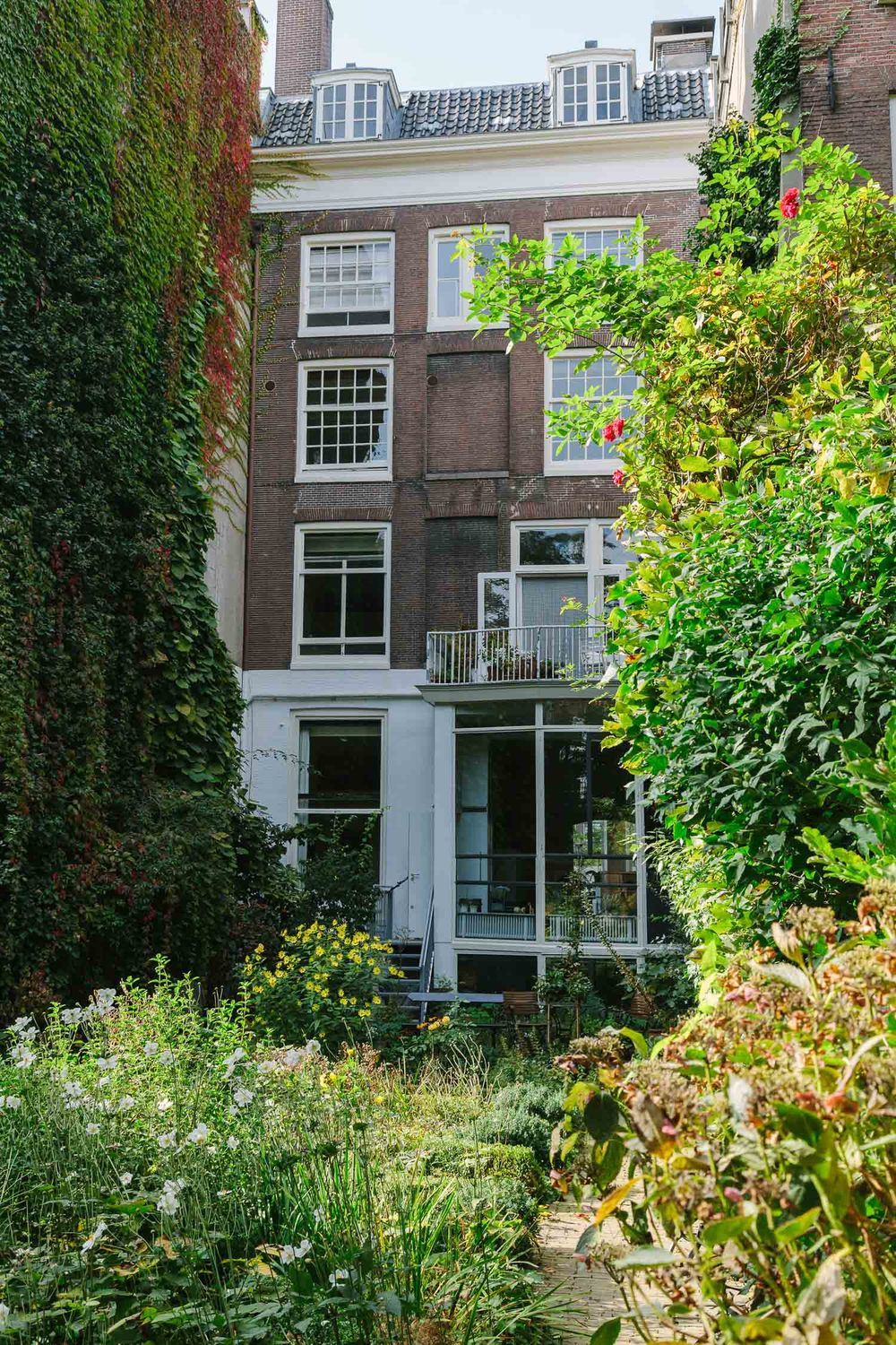 ADAC Amsterdam gardens of the old town canal houses by on a hazy