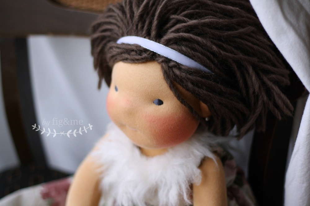 Miss Enid in a furry dress, handmade natural doll by Fig and Me.