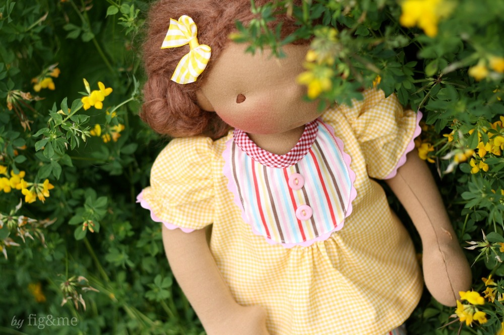 Carlotta, hiding behind the flowers. A handmade doll by Fig and Me.