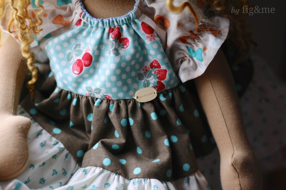 Handmade wooden button on raglan sleeve dress, by Fig and me.