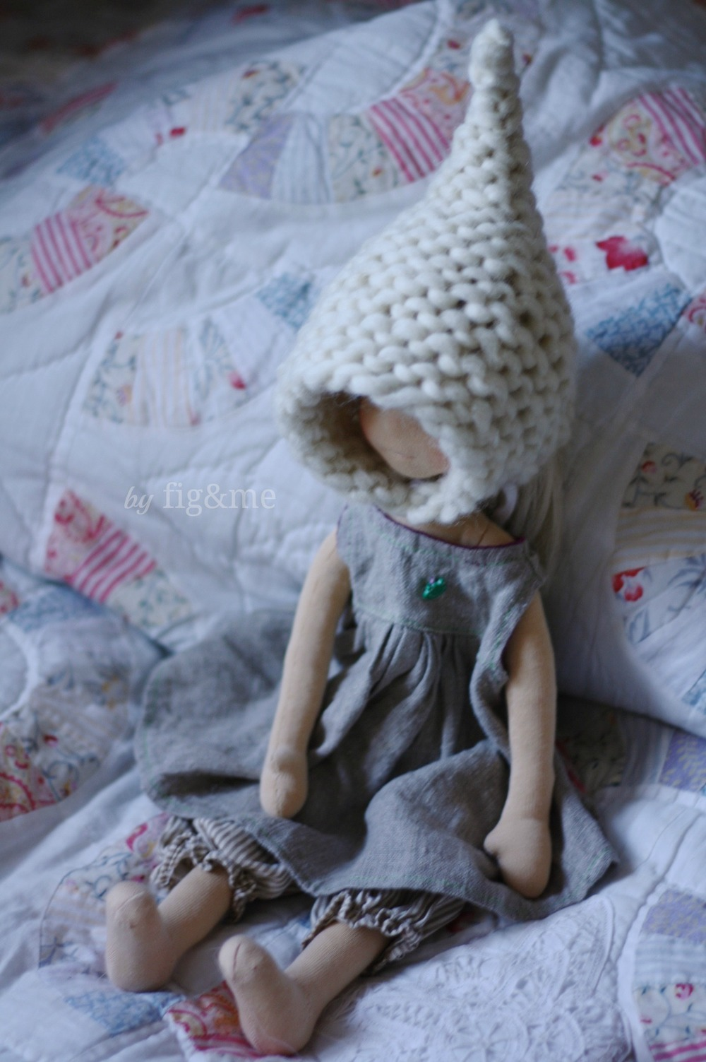 Cygnet and her hand knit hat, by Fig and me.