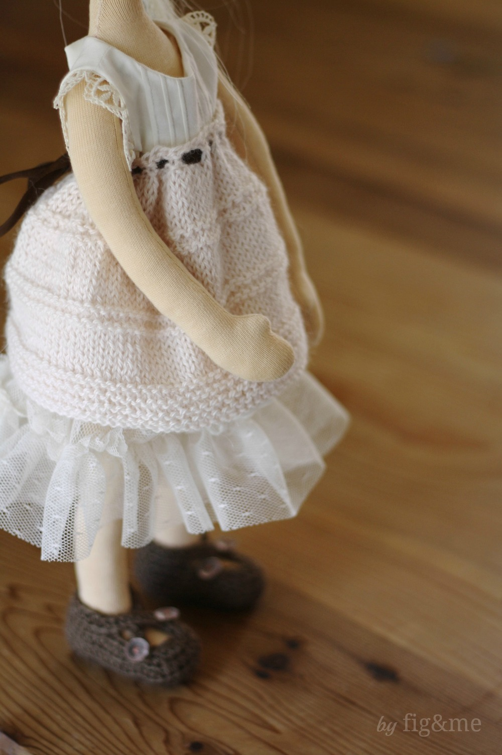 Knitted doll clothes for a little swan, by Fig and me. An alpaca overskirt, design tulle petticoat, pin tuck top with lace detail and her silk shoes with vintage glass buttons.