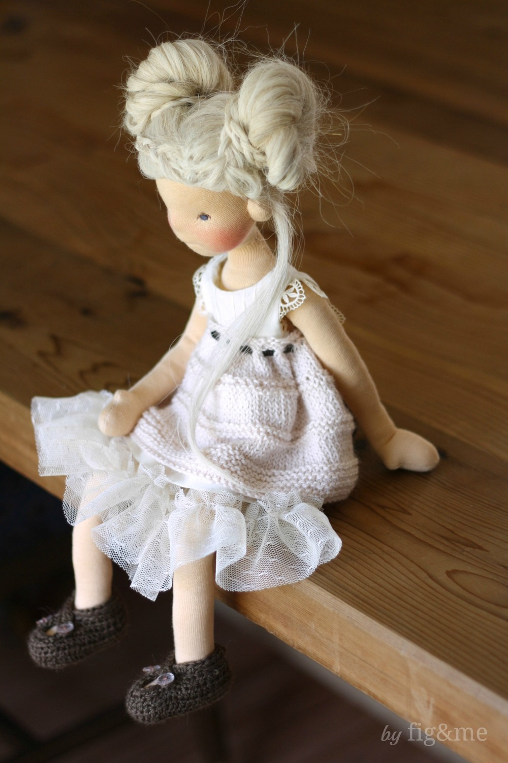 Cygnet, a Mannikin (wool sculpture) doll by Fig and me, in her dainty new clothes.