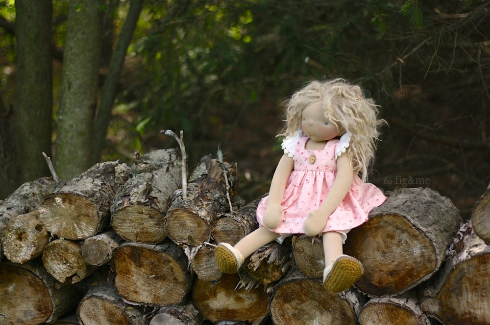 Amelie by the wood pile, by Fig and me.