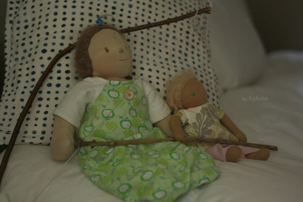 Her dolls on the bed, by Fig and me.