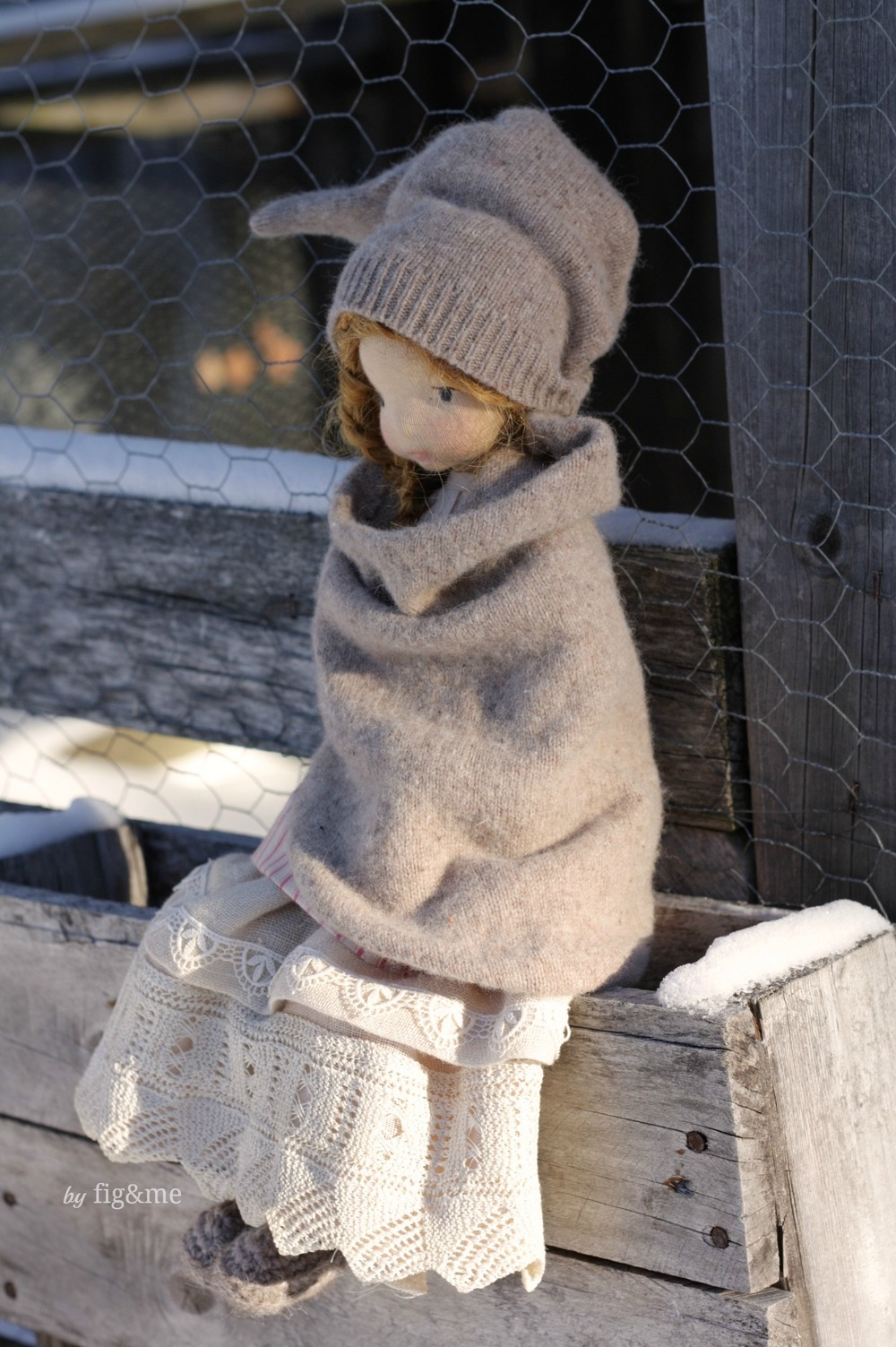 Melina in her winter clothes, a Mannikin style, natural fiber art doll by Fig and me. Wearing victorian lace and Merino clothing.