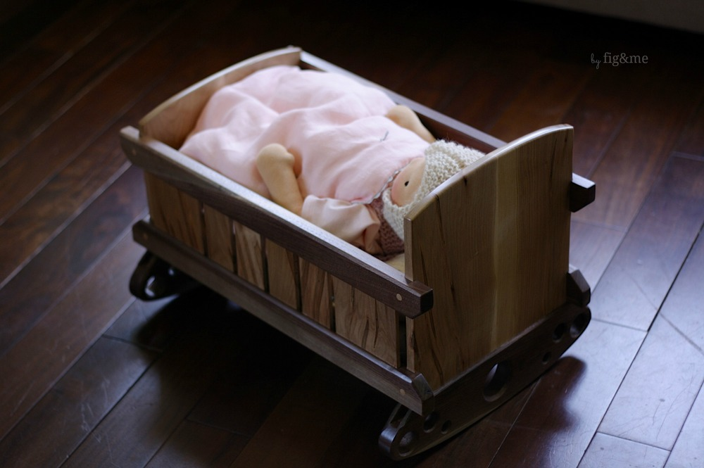 Baby Lou and her wooden cradle, by Fig&me