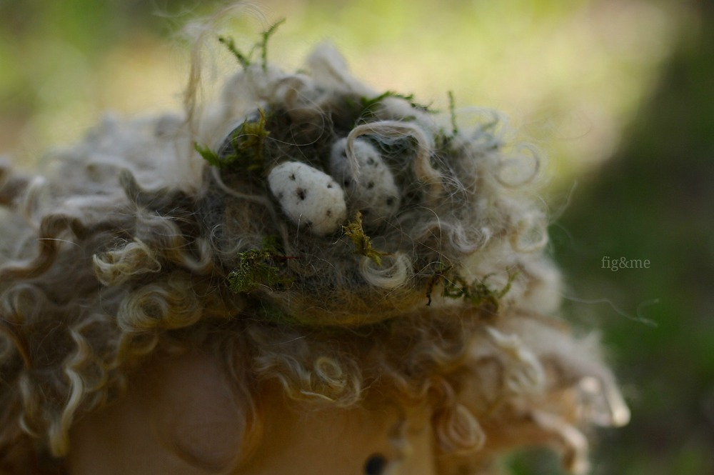 Wool nest with dry moss and speckled eggs, by Fig&me