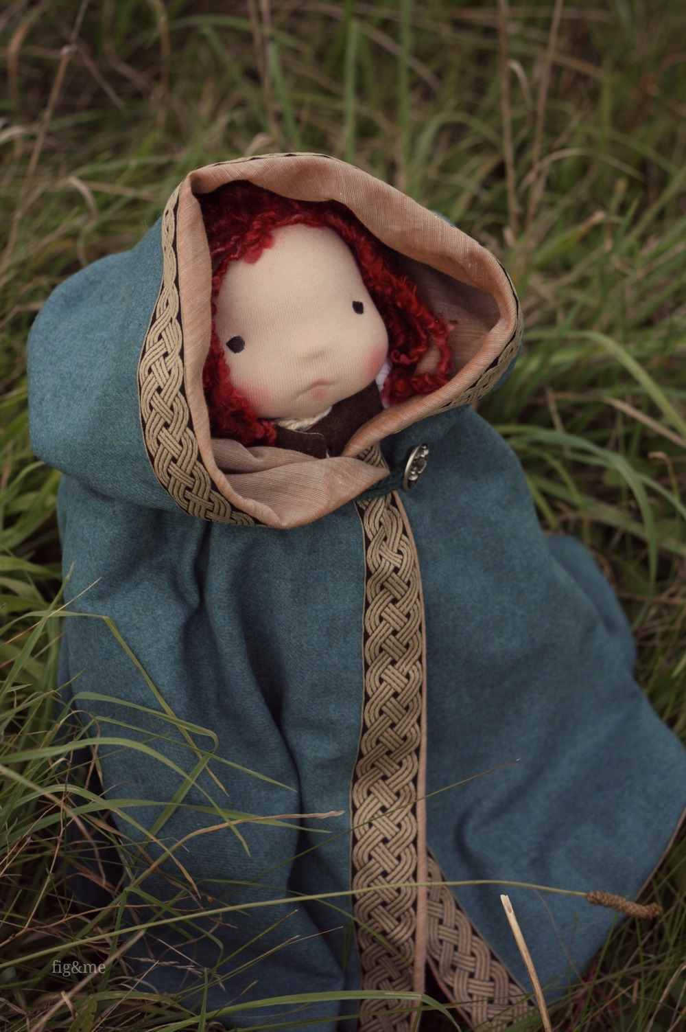 Poppy cozy in her hooded cloak, by Fig and me.