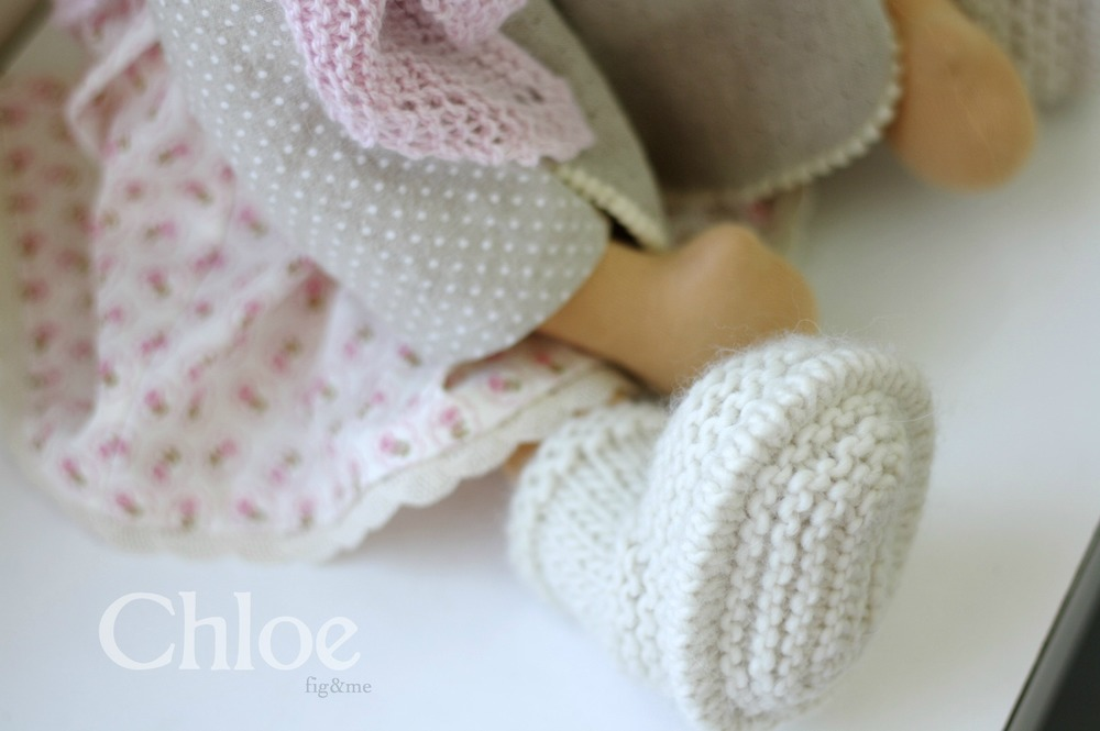Her hand knit boots, that keep those little feet ever so cozy. By FigandMe.