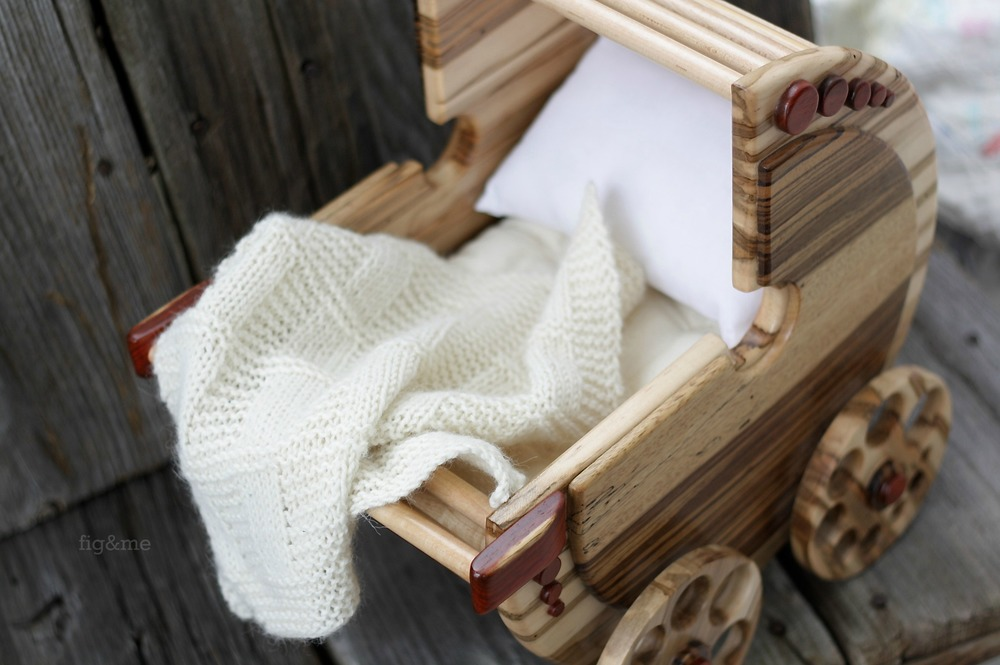 Wooden doll pram with handknit blanket, by Fig and me.