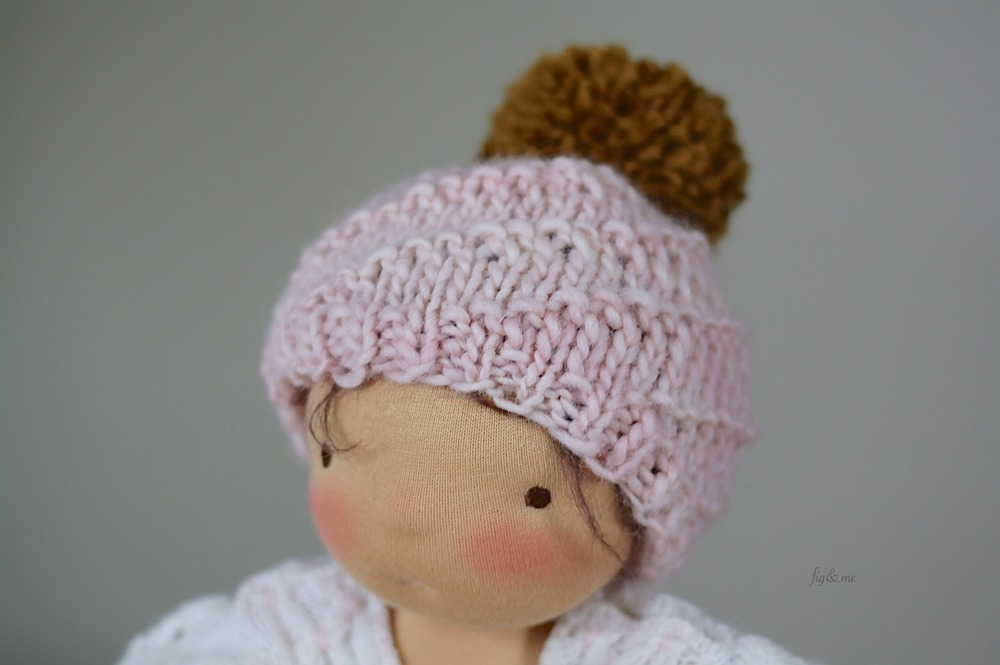 Handknit hat with a sweet pom, by Fig and Me.