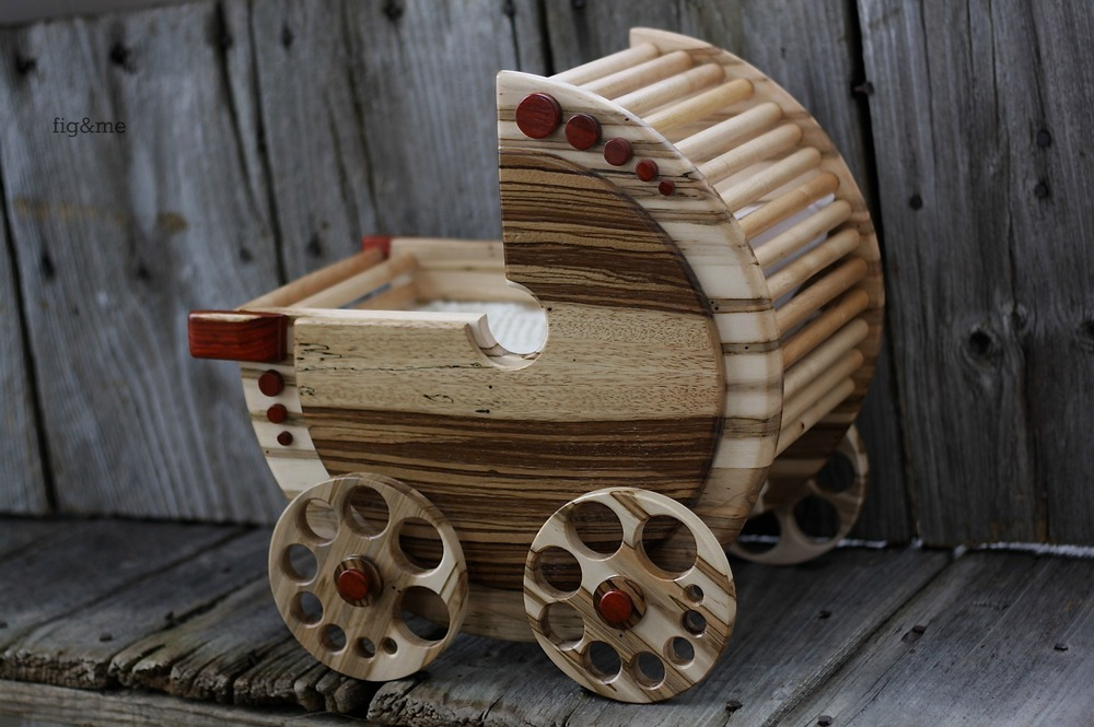 Wooden doll pram by Fig and Me.