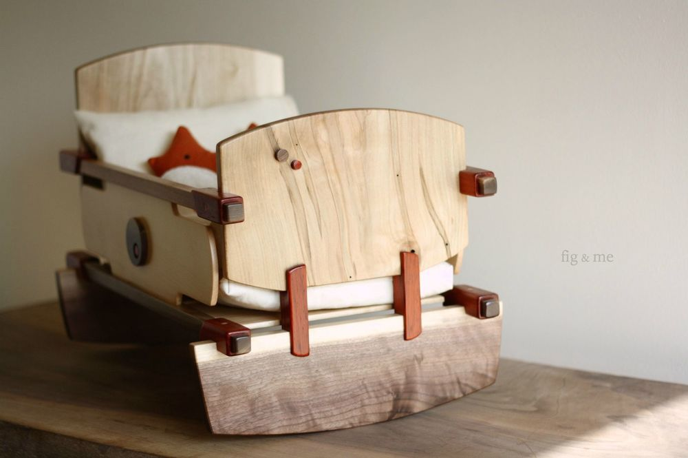 Wooden doll cradle by Fig and me.