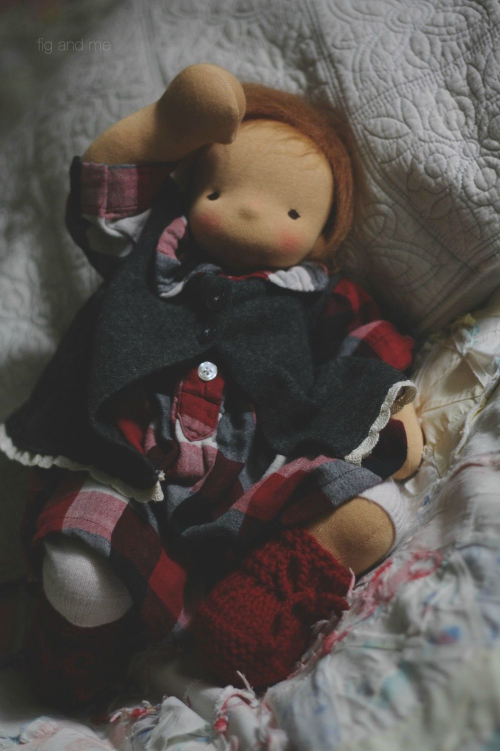 Baby Emma Jean, a natural fiber art doll ready for play, in her cotton double-gauze dress, cashmere pants, knitted baby booties and merino tea jacket. By Fig and me.