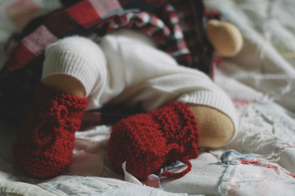 Hand knitted baby boots for Emma Jean, a natural doll by Fig and me.