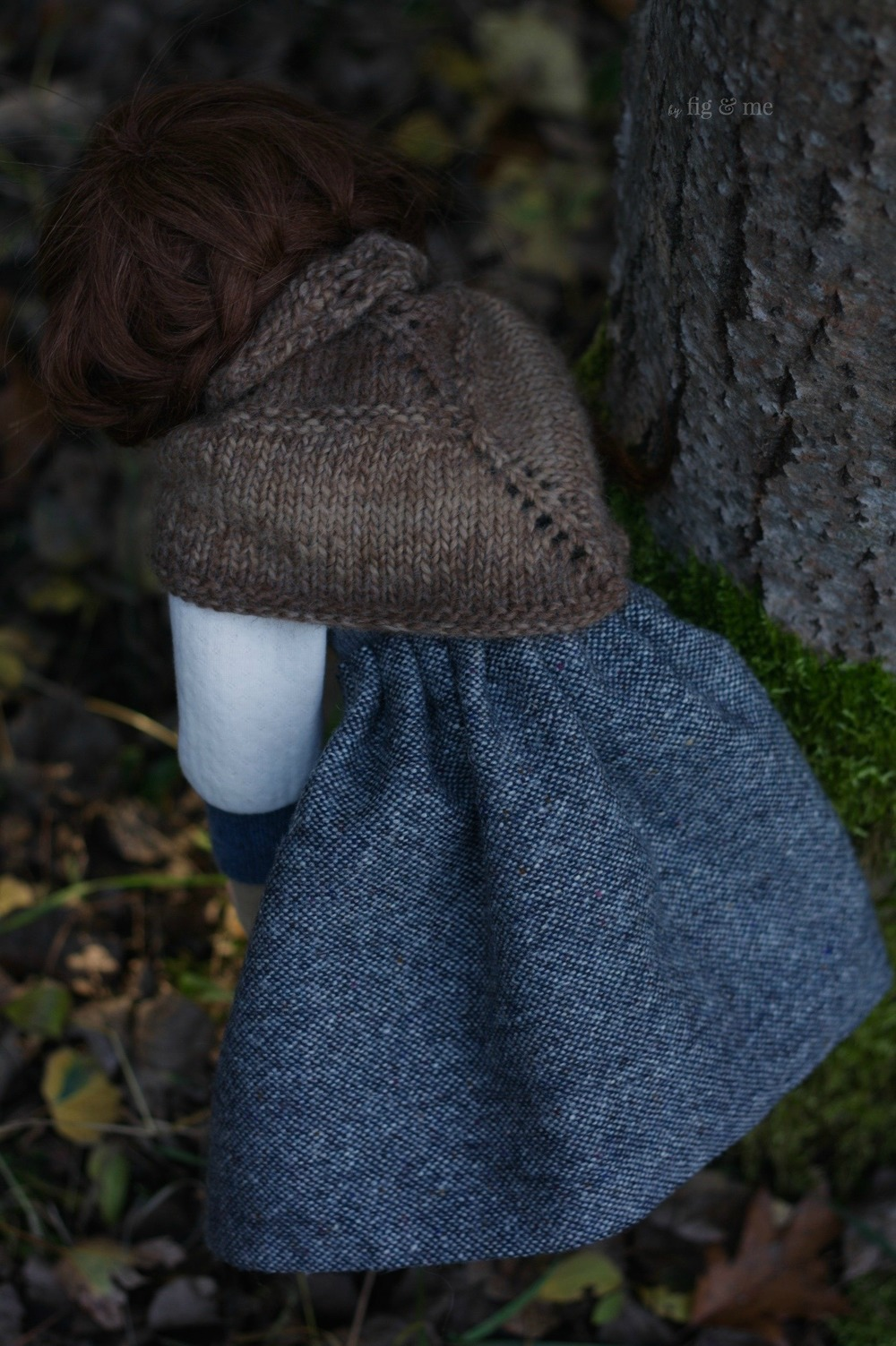 Skye picking wood for the fire, a natural fiber art doll by Fig and me.