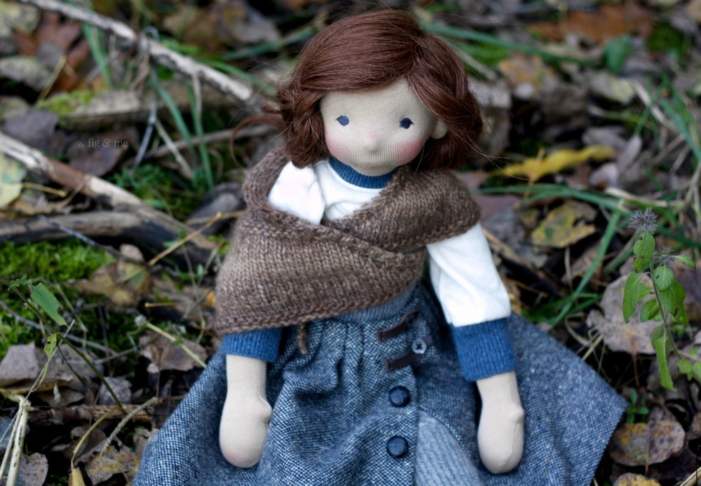 Skye, wearing her hand knit alpaca shawl and her tweed skirt, a natural fiber art doll by Fig and me.