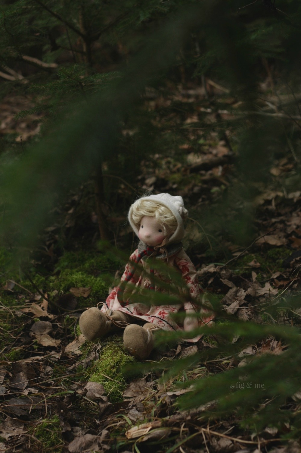 Sigrún, a natural fiber art doll playing with her sisters in the forest. Getting ready to celebrate Solstice and Christmas. By Fig and Me.