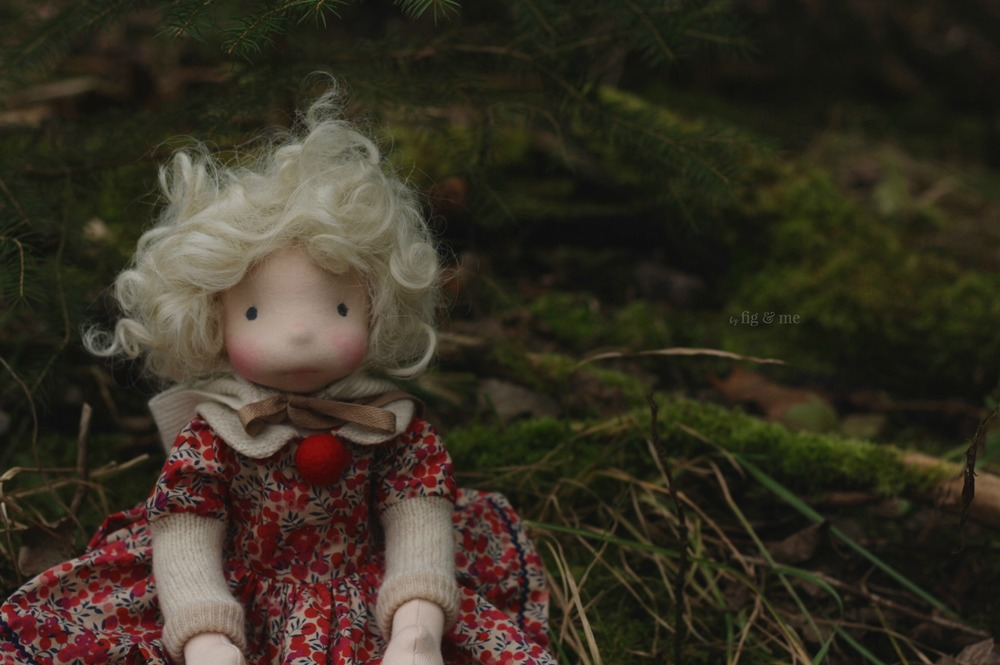 Mahthildis sitting pretty in the forest, a natural fiber art doll by Fig and Me.