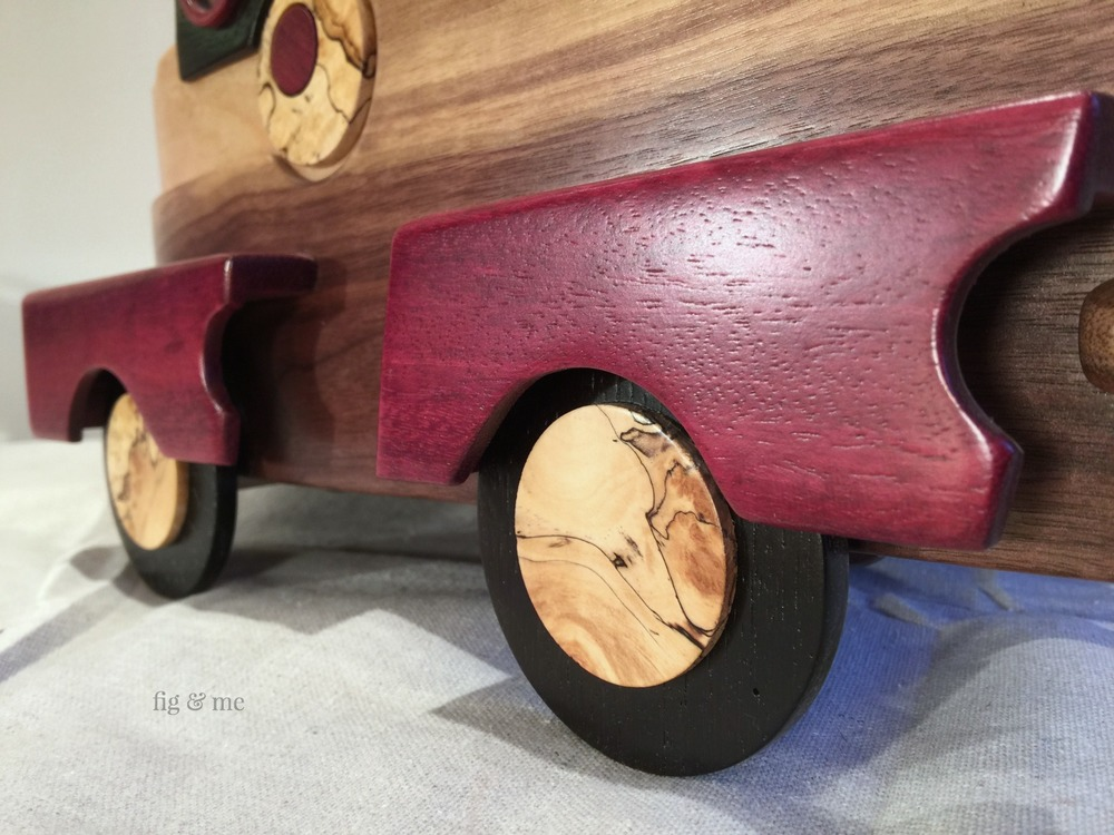 Little wheels on a wooden car, by Fig and Me.