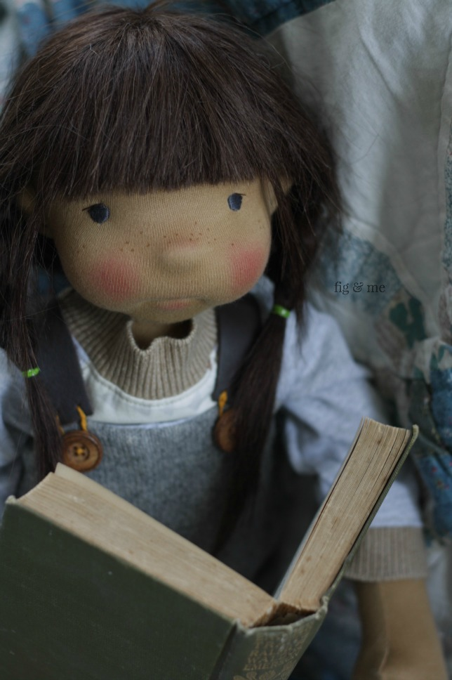 Ermentrude is a natural fiber art doll, pretending to read so I don't send her to play outside. Fig and Me.