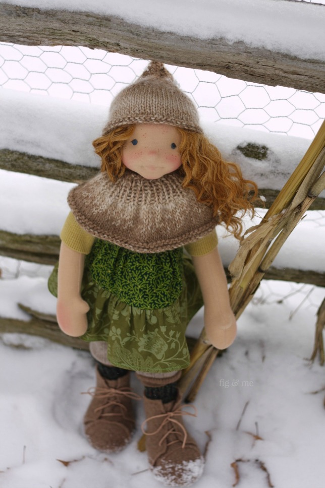Cliodhna, with her cheeky smile. A natural fiber art doll by Fig and Me.