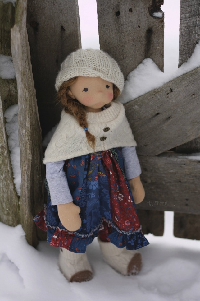 Aoife in the snow, a natural fiber art doll by Fig and Me.