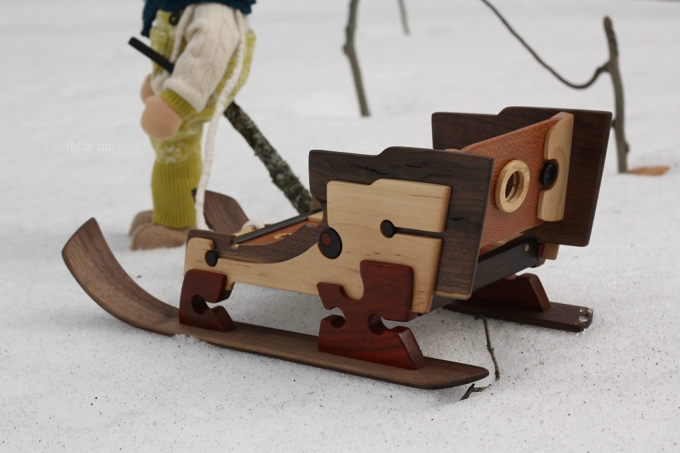 Wooden doll sleigh by Fig and Me.