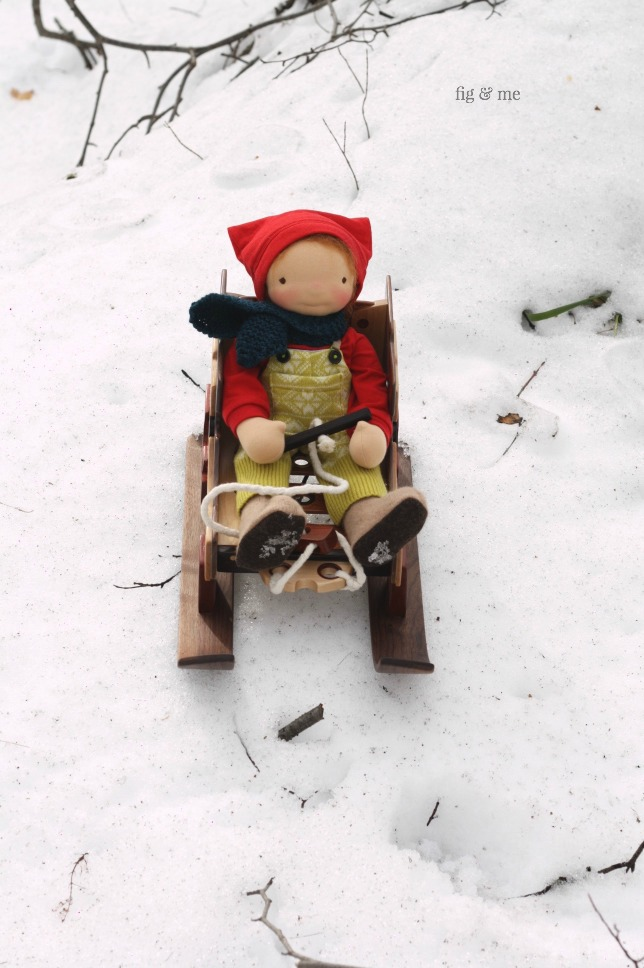 Baxter and his wooden doll sleigh, by Fig and Me.