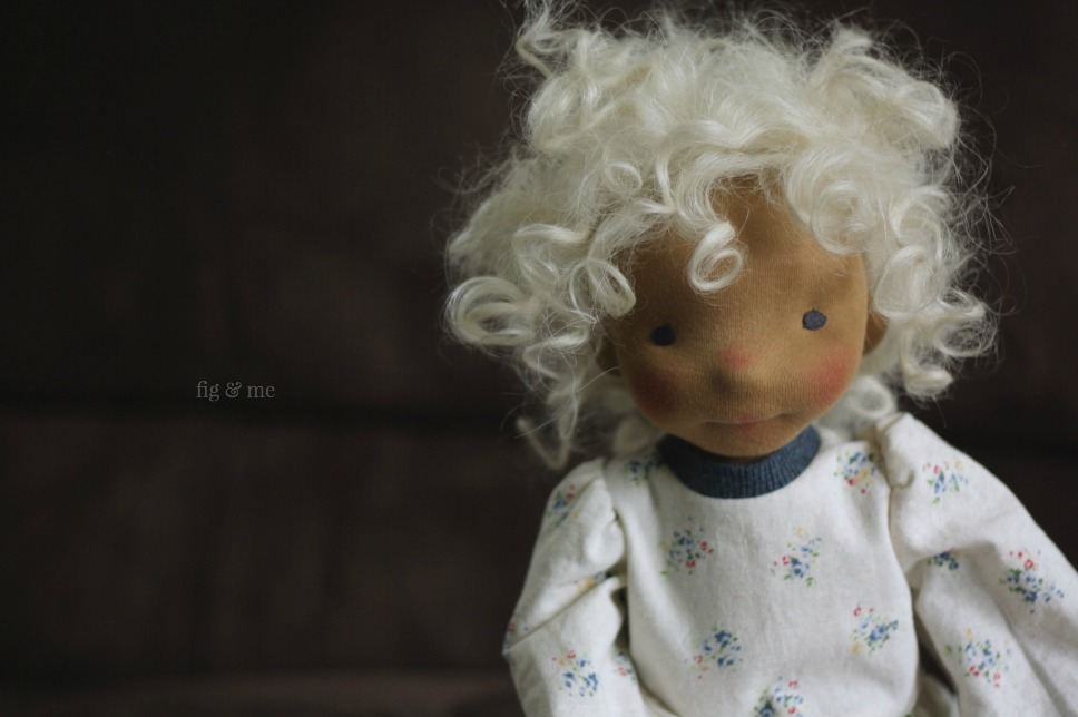 Harriet, a natural cloth doll made by Fig and Me. Wearing her linen dress and her messy curls.