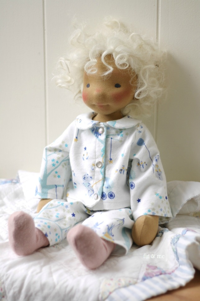 Harriet, a natural fiber art doll in her cosy flannel pyjamas, with pearl snaps and peter pan collar. By Fig and Me.