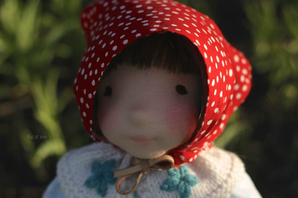Is there anything sweeter than a doll wearing a red kerchief? yes. A doll wearing one and a woollen collar with daisy stitch. I say so. This is Imogen, by Fig and Me.