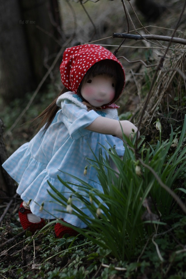 Imogen looking for snails, a natural waldorf inspired doll by Fig and Me.