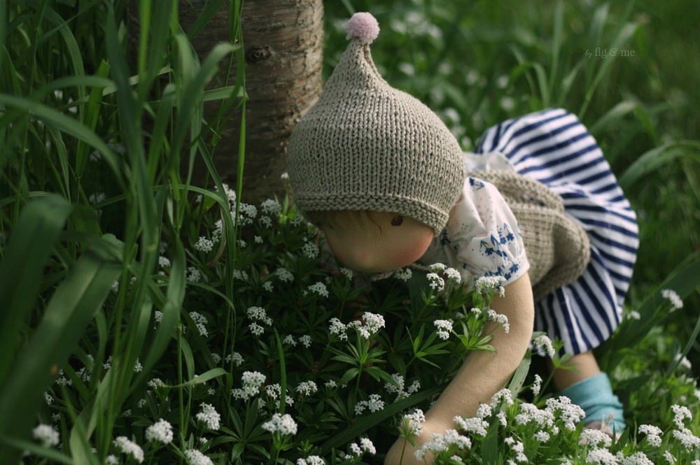 Saskia looking for fairies. A natural cloth doll by Fig and Me.