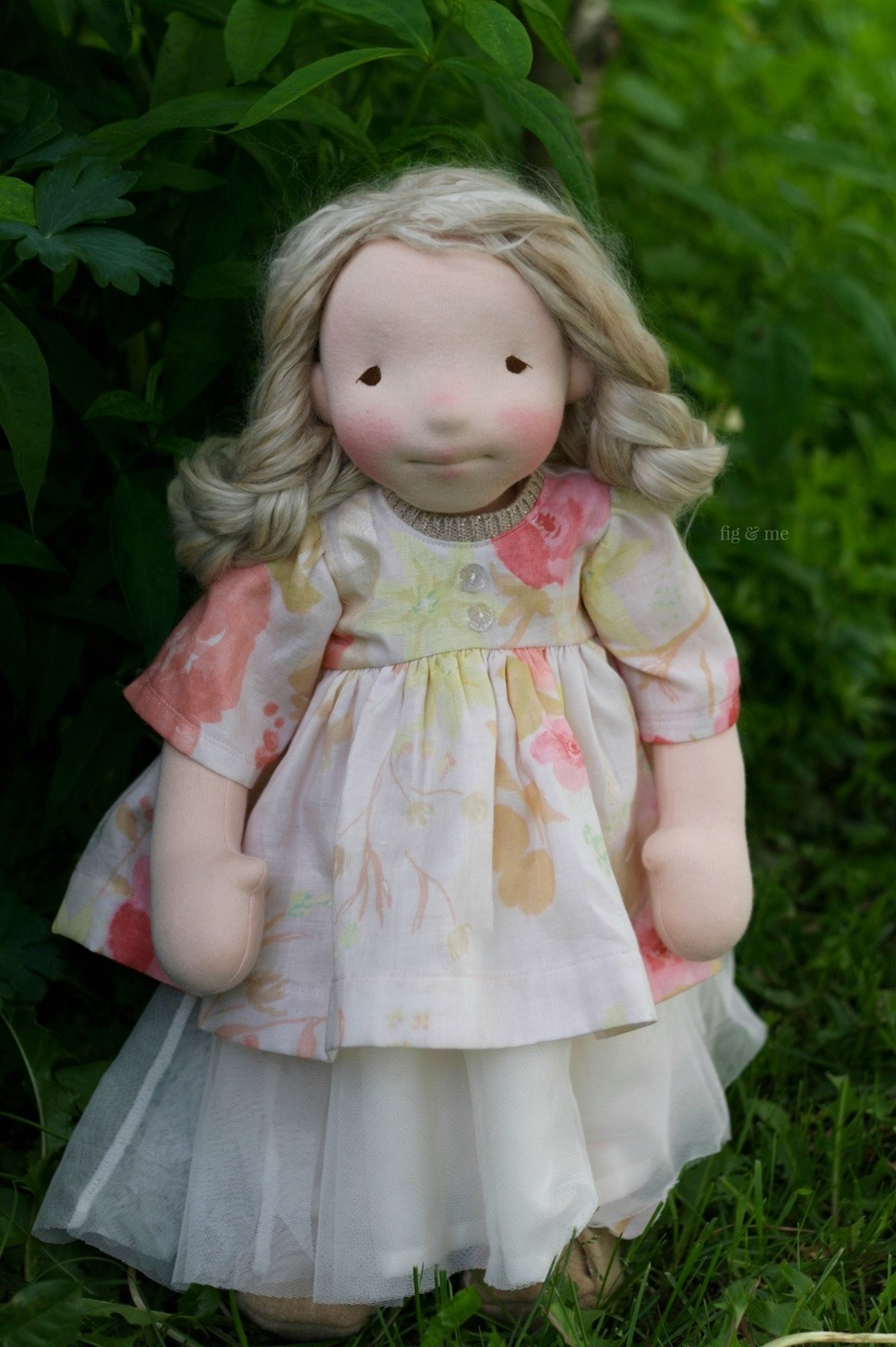 Phoebe, a one of a kind natural fiber art doll, by Fig and Me. She wears a tulle dress with cotton jersey top and a shorter dress/coat made of cotton double gauze with vintage glass buttons. By Fig and Me.