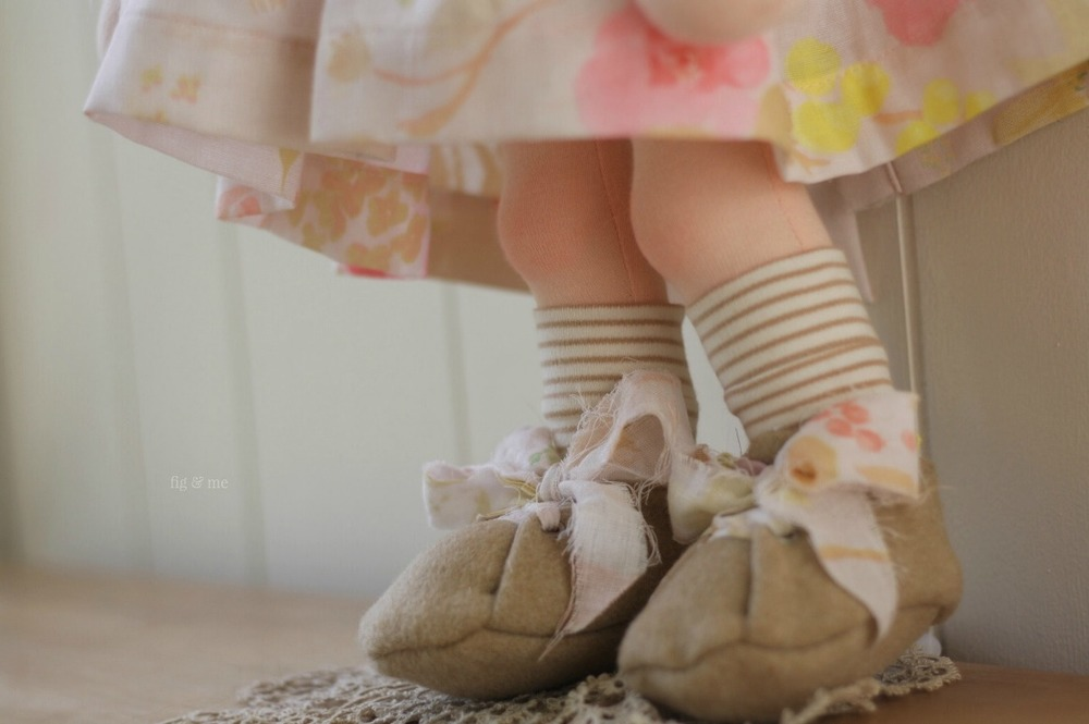 Phoebe is a doll modelling her italian wool shoes, fabric ties and stripe socks. By Fig and Me.