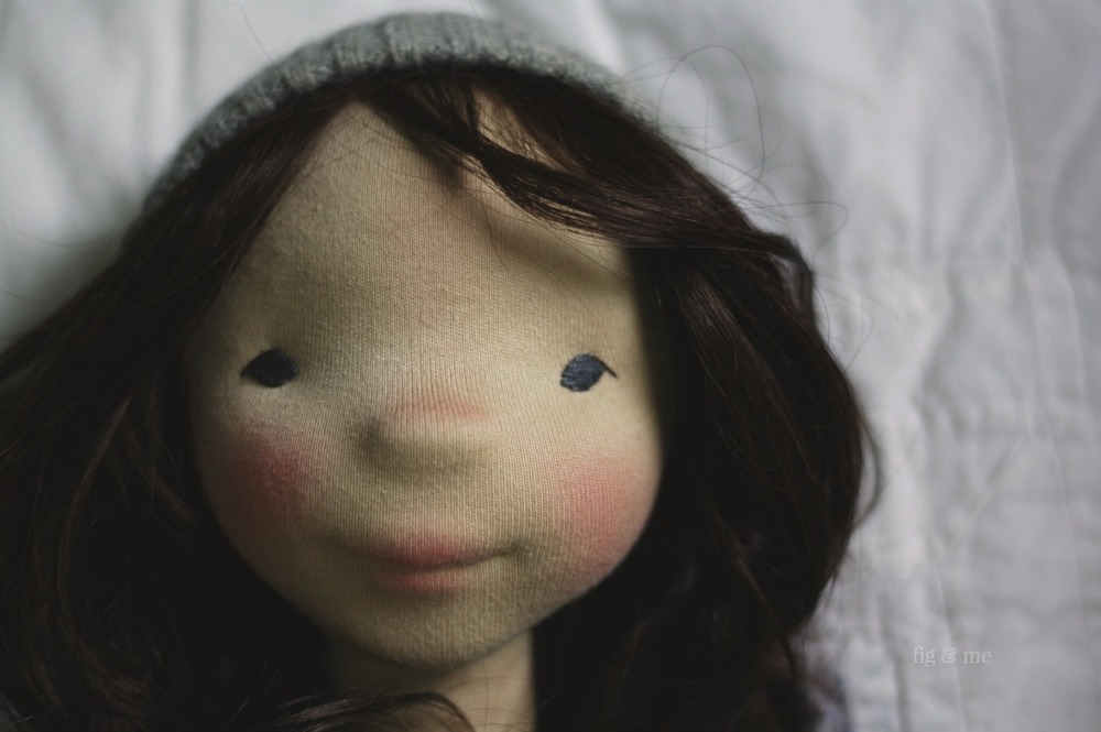Dagmar, a natural cloth art doll by Fig and Me. Long dark brown mohair weft and blue eyes.