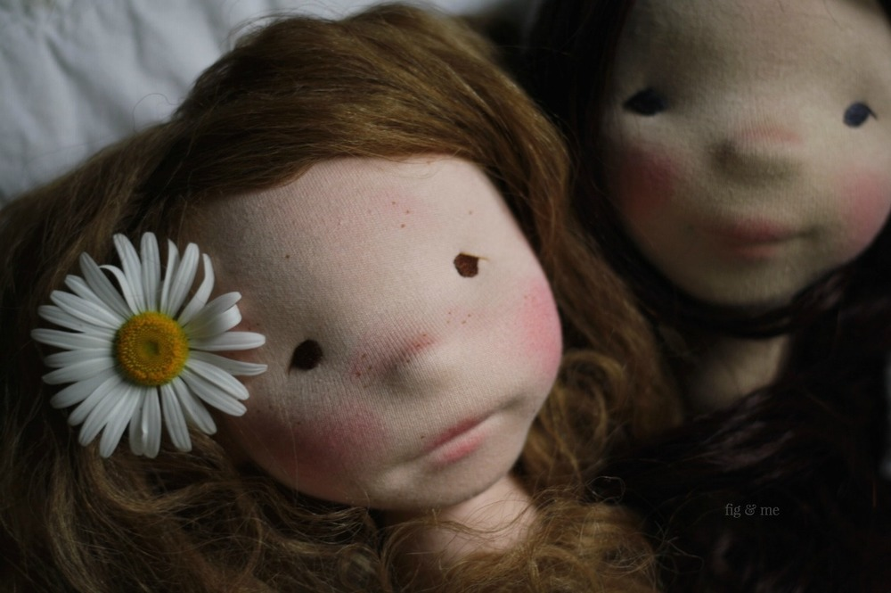 Hedwig and her daisy, a natural fiber art doll by Fig and Me.