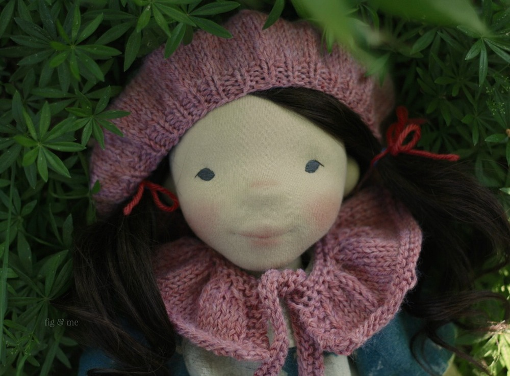 Dagmar, wearing her knitted beret and her ruffle collar. A natural cloth doll by Fig and Me.