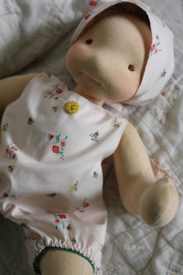 Baby doll Maia in her cotton balloon rompers, with a pretty mustard wooden button and green elastic. It's those little things that make my sewing hands sing (and clap too!). By Fig and Me.