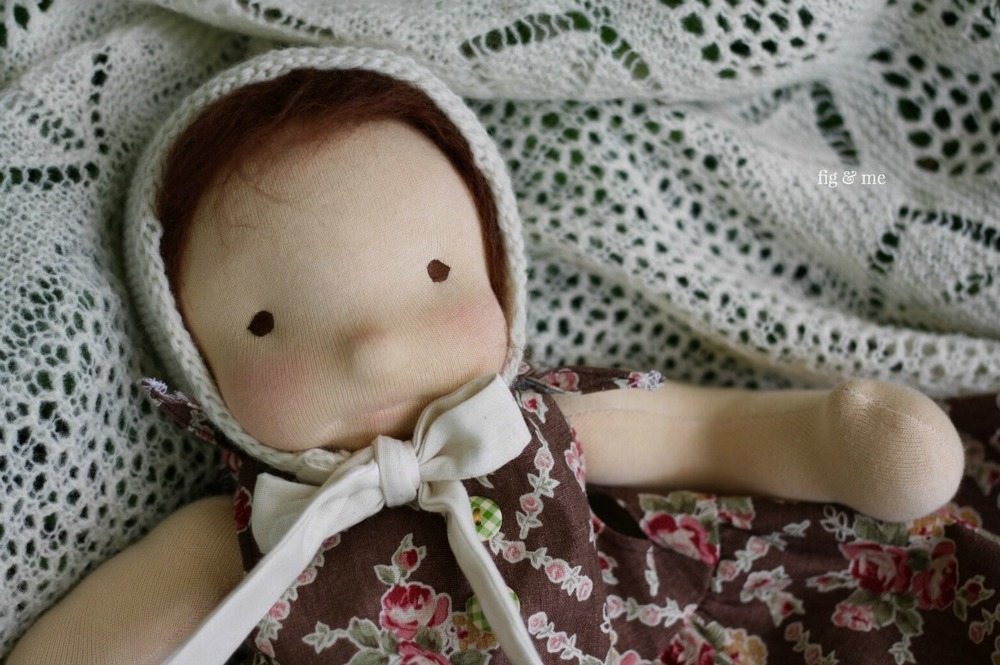 Baby doll Maia in her choco dress, by Fig and Me.