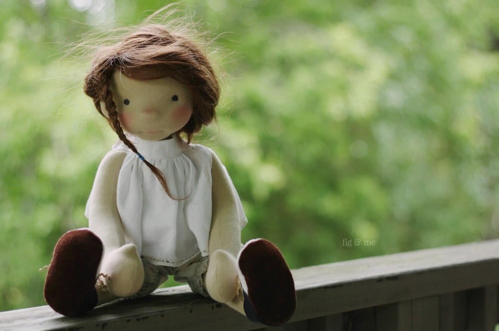 Adelheid playing on the deck. A natural fiber art doll by Fig and Me.