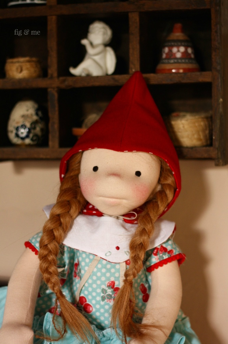Pippa wearing her red wool hat, her removable linen collar and her strawberry outfit. By Fig & me.