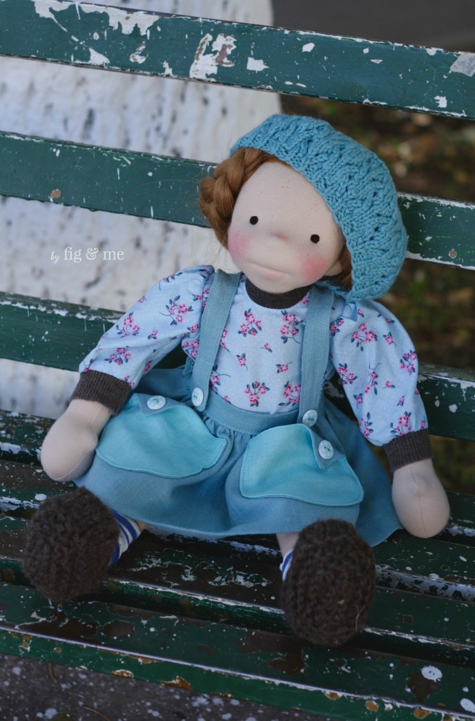 "Pippa, a natural waldorf-inspired cloth art doll by Fig and Me. She measures almost 18"" tall, is made with soft cotton skin and stuffed with warm wool. Her hair is made of camel weft. Wears all-natural fibers."